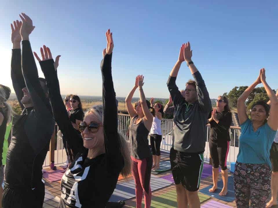 Asim organizes a rooftop yoga event